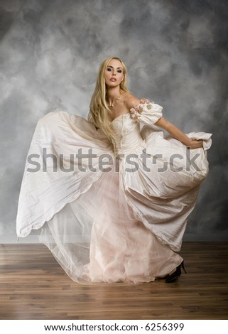 Full length view of blonde woman modeling vintage dress