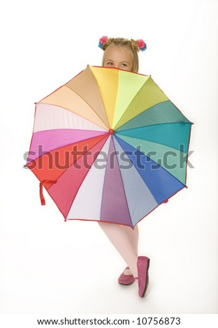 Full length view of five year old girl standing with colorful umbrella. White background. - stock photo
