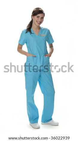 Full length view of pretty female healthcare worker standing wearing scrubs. White background. - stock photo