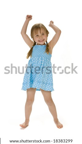 Full length view of 4 year old girl standing with arms raised, smiling. Wearing polka dot dress, white background. - stock photo
