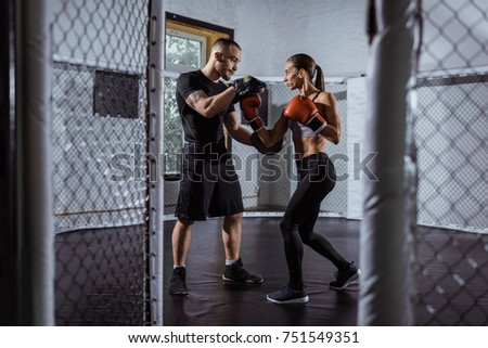 full length view of young couple of boxers training together