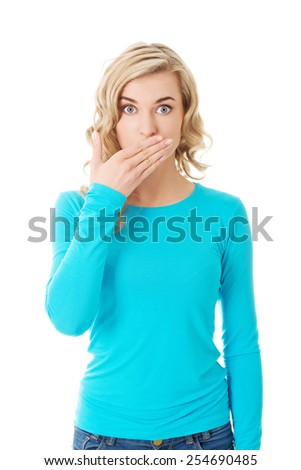 Full length woman covering her mouth. - stock photo