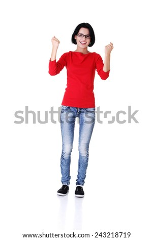 Full length woman in a winner gesture. - stock photo