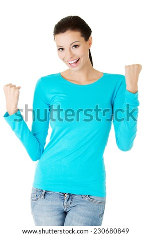 Full length woman making winner gesture. - stock photo