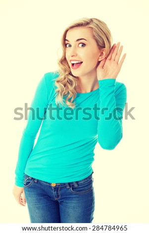 Full length woman overhearing a conversation. - stock photo