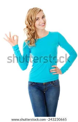 Full length woman showing ok sign. - stock photo