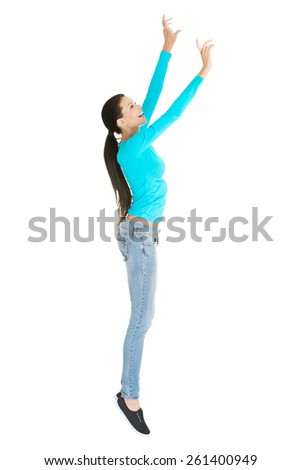 Full length woman trying to reach high. - stock photo