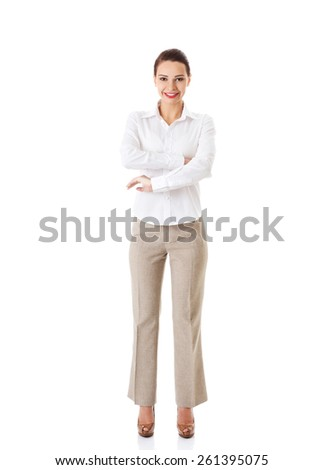 Full length young businesswoman with folded arms. - stock photo