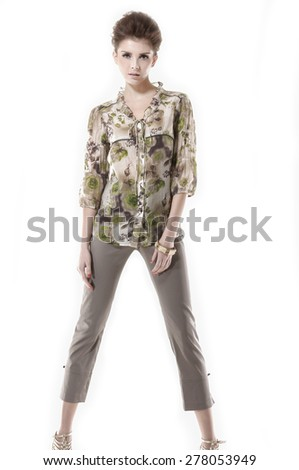 full-length young girl posing in studio - stock photo