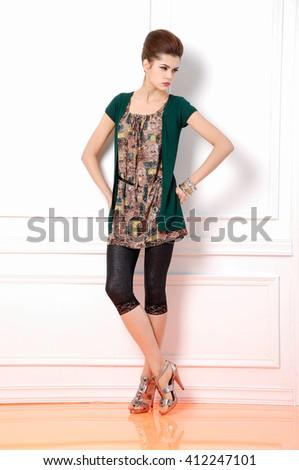 full-length young girl posing in studio - stock photo