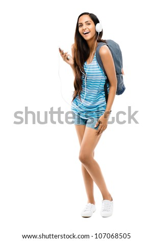 Full length young Indian teenage schoolgirl white background - stock photo
