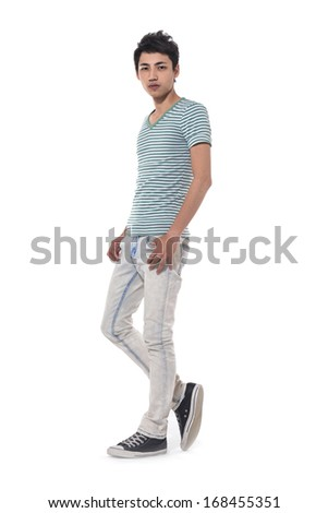 Full length Young man in jeans standing on white background