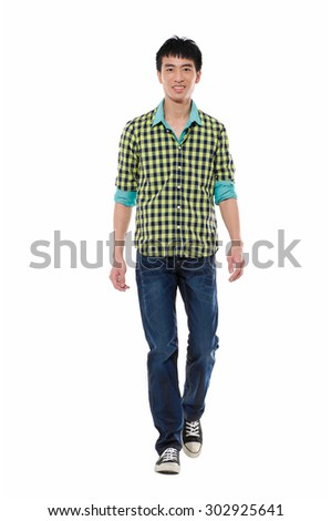 Full length Young man in jeans walking on white background - stock photo