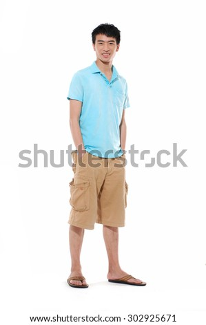 Full length Young man in shorts standing posing in studio  - stock photo