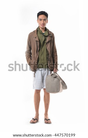 Full length young man standing on white background  - stock photo