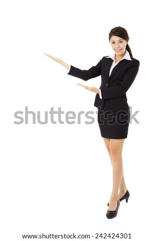 full length young smiling businesswoman with showing gesture - stock photo