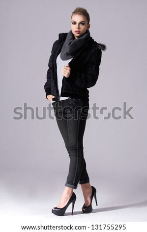 full length young woman in a scarf over light background. - stock photo