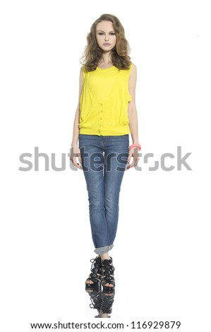 full length young woman in jeans posing on white background - stock photo
