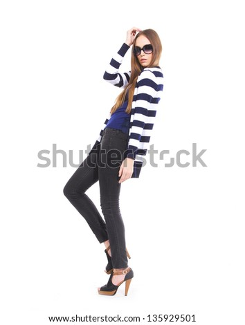 full-length young woman in stripy shirt with sunglasses posing at studio - stock photo