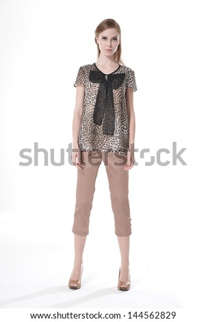 Full length young woman posing white background - stock photo