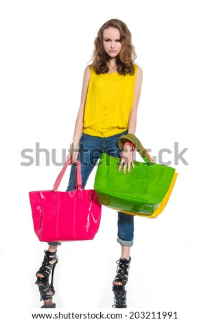 Full-length young woman with colorful bag over white background - stock photo