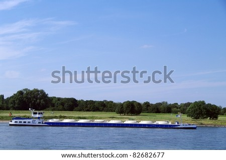 Full load riverboat with oil - stock photo