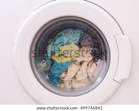 Full loaded washing machine. Close up.
