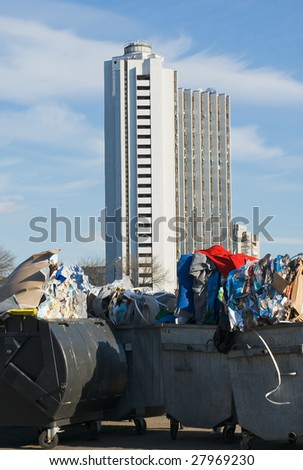 full metal garbage containers stand in the street - stock photo