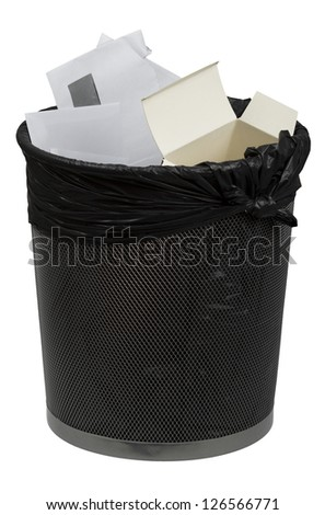 Full metal trash bin for paper with trash bag isolated on white - stock photo