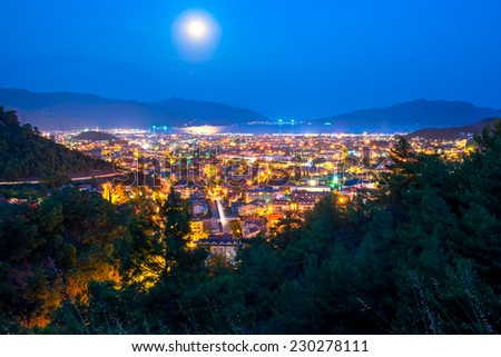 full moon above the spa town of the Aegean Sea - stock photo