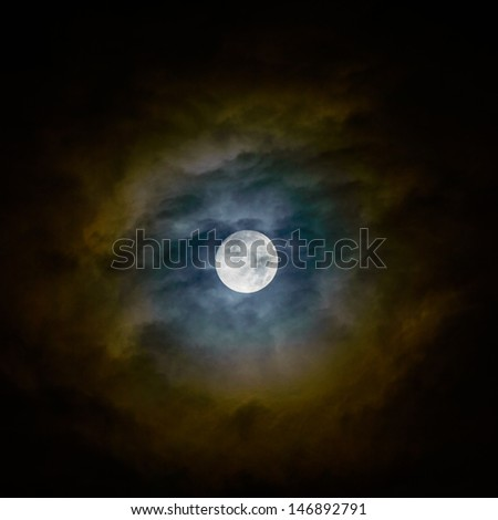 Full moon and clouds on night sky. - stock photo