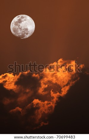 full moon and red hot clouds during tropical sunset - stock photo