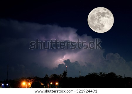Full moon and thunder lightnings and storm at dark night background, parts of this image furnished by nasa