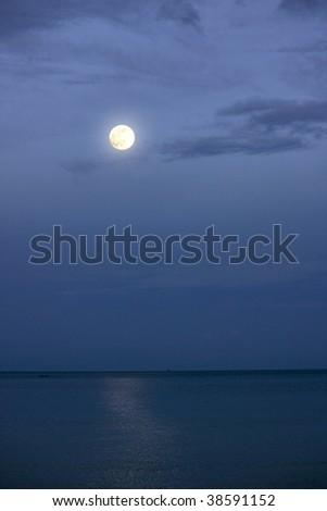 full moon at the ocean - stock photo