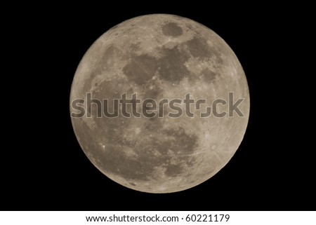 Full moon closeup showing the details of the lunar surface - stock photo