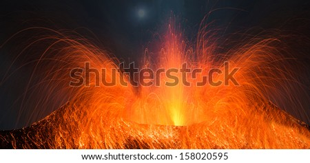 Full moon eruption of a volcano in the night Heavy volcanic activity - stock photo