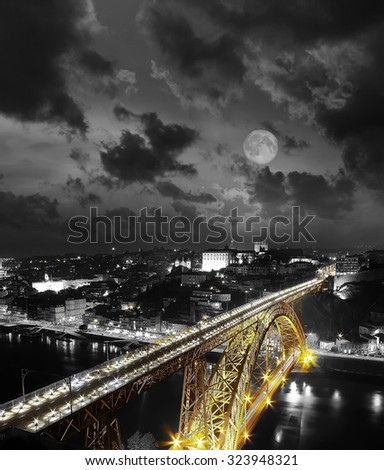 Full moon Golden Bridge on a monochromatic background, night view of the Dom Luiz bridge captured on a slow shutter, Porto , Portugal . Vintage picture - stock photo