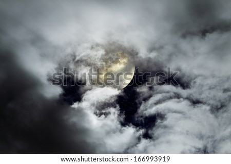 Full moon in a cloudy night - stock photo
