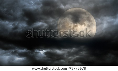 Full moon in a stormy overcast night - stock photo