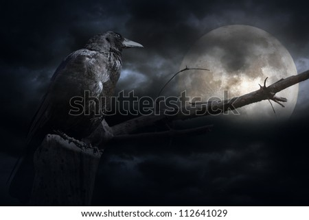 Full moon in a stormy overcast night with crow and naked tree - stock photo