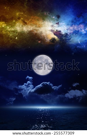 Full moon in night sky, mysterious glowing horizon over dark blue sea, nebula and stars in space. Elements of this image furnished by NASA nasa.gov - stock photo