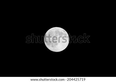 Full moon in the night sky - stock photo