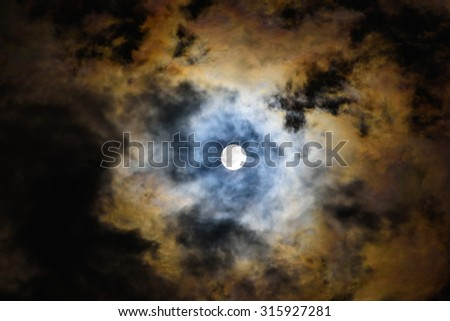 full moon night the moon is shining through the cloud - stock photo