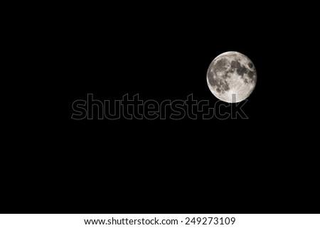 Full Moon on a black night sky - stock photo