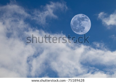 Full Moon on Blue Sky with Cumulus Clouds - stock photo