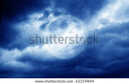 full moon over dark sky - stock photo