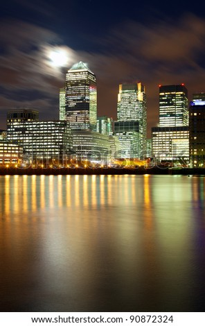 Full moon over London skyscrapers - stock photo