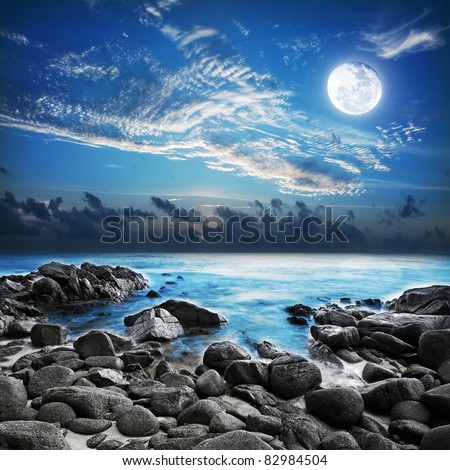 Full moon over the tropical bay. Long exposure shot. - stock photo