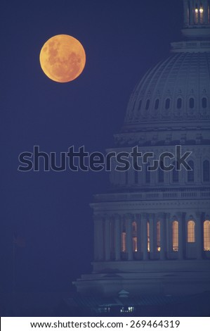 Full moon over U.S. Capitol in Washington, D.C. - stock photo