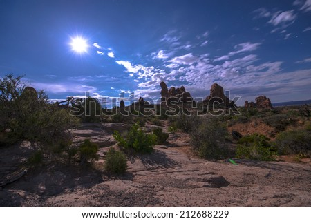 Full moon rise over Turret Arch - Arches National Park Utah  - stock photo
